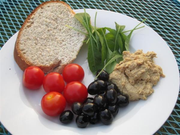 Homemade hummus and bread and salad