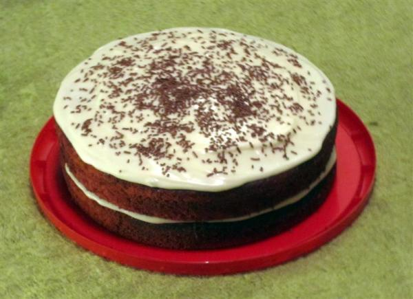 Red velvet cake with cream cheese icing. And chocolate sprinkles.
